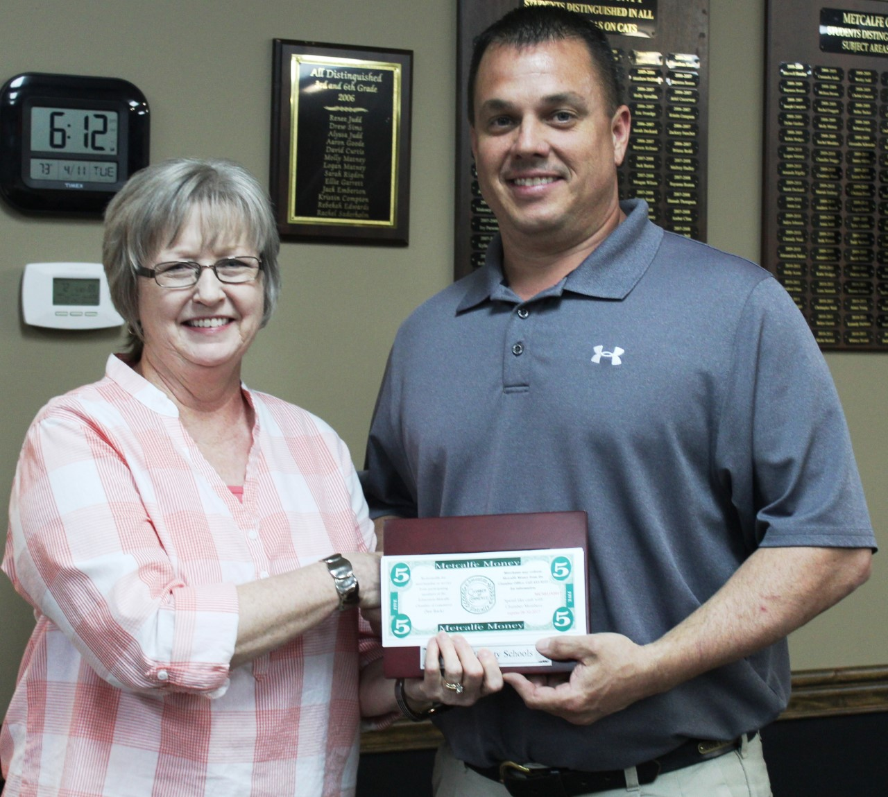 School Board Chairman Joey Shive Presents Vickie Harper with the Classified Employee of the Month Award